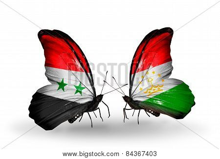 Two Butterflies With Flags On Wings As Symbol Of Relations Syria And Tajikistan