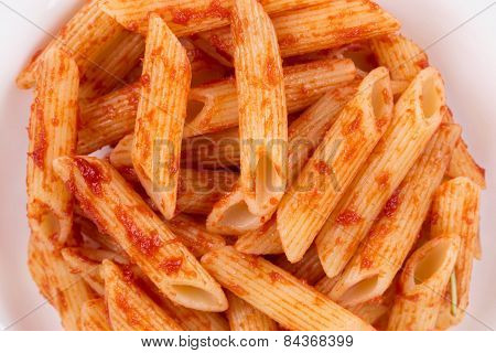 Pasta penne rigate with tomato sauce.
