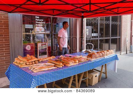 Vendor Selling Bread At The Saint Aubin Market