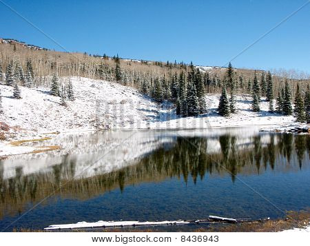 Mountain Lake After Early Snowfall
