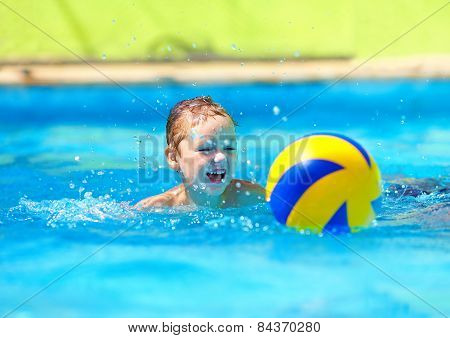 Cute Kid Playing Water Sport Games In Pool