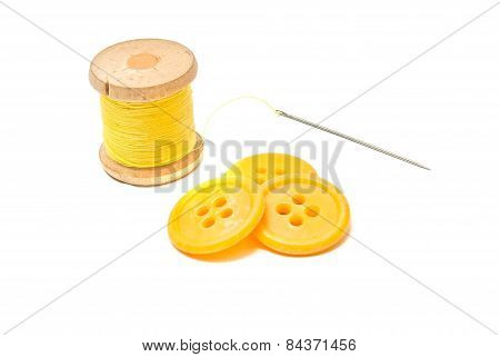 Buttons And Spool Of Yellow Thread