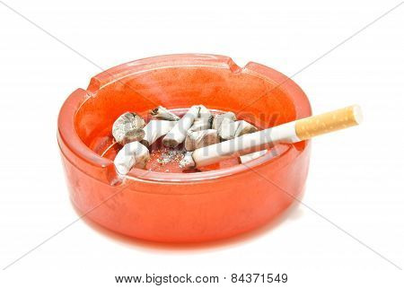 Cigarette And Butts In Glass Ashtray