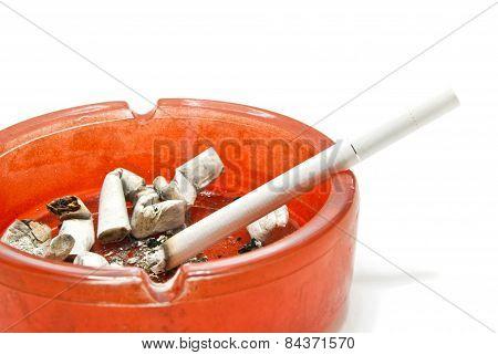 Cigarette In Red Glass Ashtray