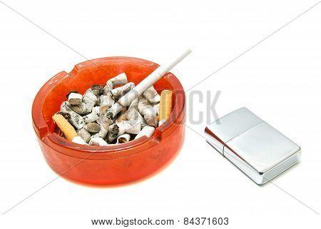 Silver Lighter And Cigarette In Ashtray