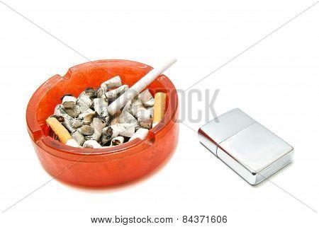 Silver Lighter And Single Cigarette
