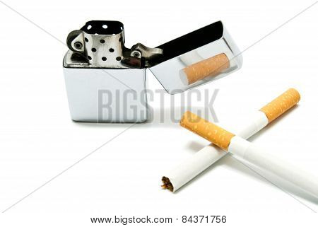 Metal Lighter And Two Cigarettes Closeup