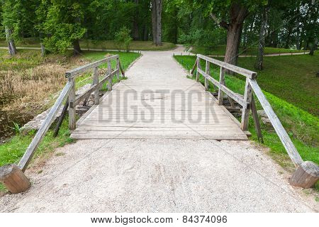 Old Wooden Bridge And Walking Lane In Park