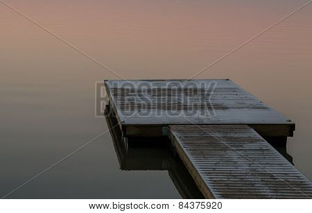 Snowy Wooden Pier On The Lake