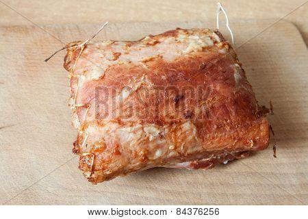 Roast meat lies on a board
