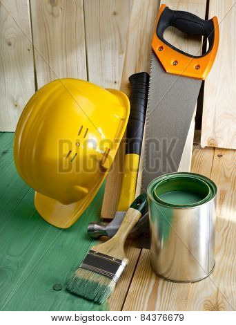 Green Wood Floor With A Brush, Saw, Hammer And Helmet