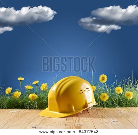 Construction Helmet On Blue Nature Background
