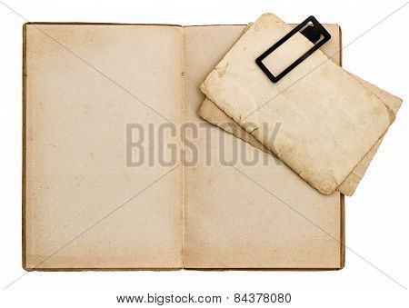 Open Old Book With Cardboard And Clip Isolated On White