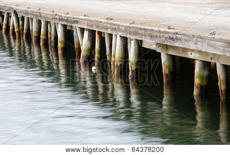 Wharf Reflecting In Water
