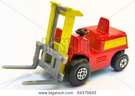 Red And Yellow Industrial Fork Lift Loader Truck Toy Isolated On White