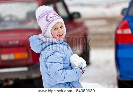 The girl with a snowball in hands