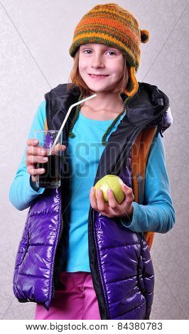 Girl With Backpack And Hat Drinking Cola