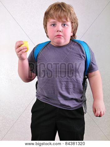 Portrait Of Schoolchild Eating Apple