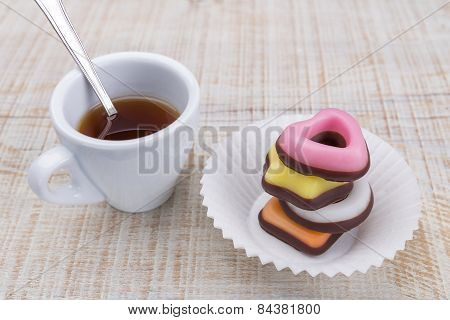 Valentine Cookies In A Stack In A Paper Napkin. With A Cup Of Coffee.