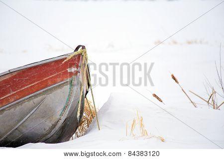 Bow of canoe in deep snow
