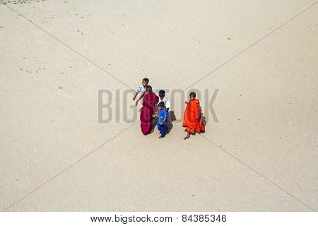 Young Monk Guides His Child Friends To The Temple