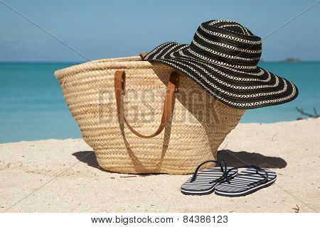 Wicker Bag Hat And Flip Flops