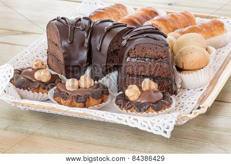 mixed dark chocolate cakes and cream pastries