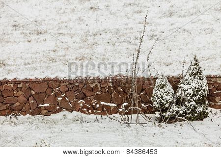 View Of Stone Fence On Field Wintertime