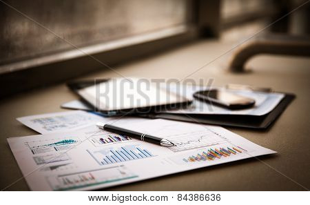 business documents with charts growth keyboard and pen.