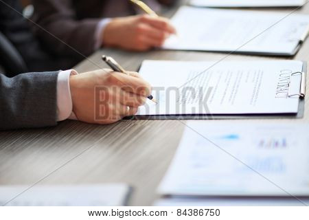 Business young people in the job interview signed