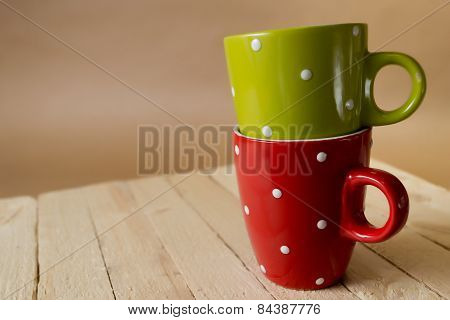 Two cups on the wooden table