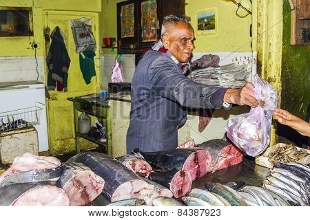 Man Sells Fresh Fish In His Shop