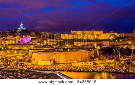 Night View Of Fort St. Nicolas And Notre-dame-de-la-garde In Marseille, France