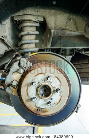 Close Up Of Disk Brake On Car In Process Of Damaged.- Brake Job In Progress.