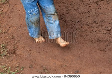 Kid Dirty Feet On Muddy Ground