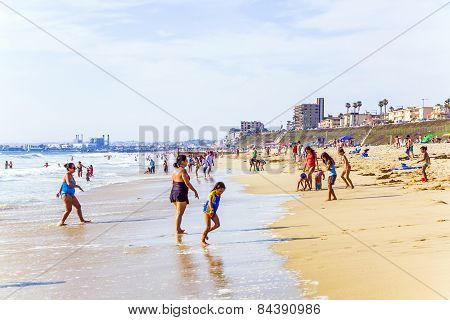 People Enjoy The Beach