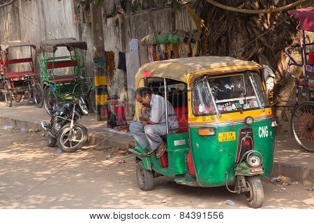 Delhi, India - November 5: Unidentified Man Sits In His Tuk-tuk On November 5, 2014 In Delhi, India.