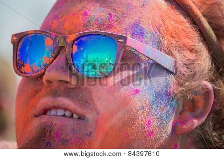 Unknown Man With Painted Face And Glasses Looking At The Stage