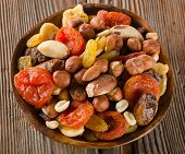 picture of mixed nut  - Healthy Mix nuts and dried fruits on wooden background - JPG
