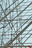 stock photo of scaffold  - Part of the construction scaffold with blue background - JPG