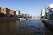 picture of mixture  - Sandtorhafen in the Hafencity in Hamburg Germany with a mixture of old and new architecture - JPG