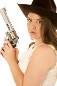 stock photo of cowgirl  - Cowgirl with revolver looking serious at camera - JPG