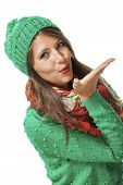 stock photo of sweethearts  - Romantic pretty young woman in a knitted green winter outfit blowing a kiss across the palm of her hand to her sweetheart or while flirting isolated on white - JPG
