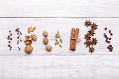 pic of christmas spices  - spices ingredients for glintwine on wooden background - JPG
