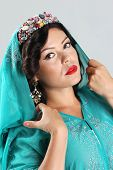 foto of yashmak  - Adult Beautiful arabian woman in blue abaya - JPG