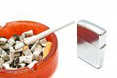 picture of cigarette lighter  - silver lighter and cigarette on white background - JPG