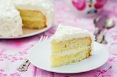 stock photo of vanilla  - cake with vanilla cream in the form of roses on a pink background - JPG