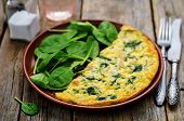 image of chicken  - Frittata with chicken and spinach and fresh spinach on a dark wood background - JPG