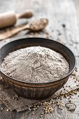 picture of buckwheat  - Buckwheat flour in a bowl on a wooden table - JPG