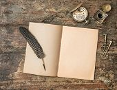 foto of inkwells  - Open book and vintage writing accessories - JPG